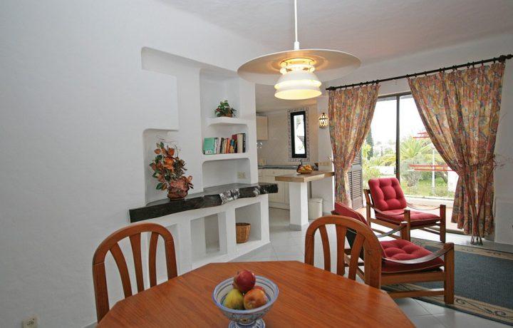 Prado do Golf - Standard villa interior lounge dining area